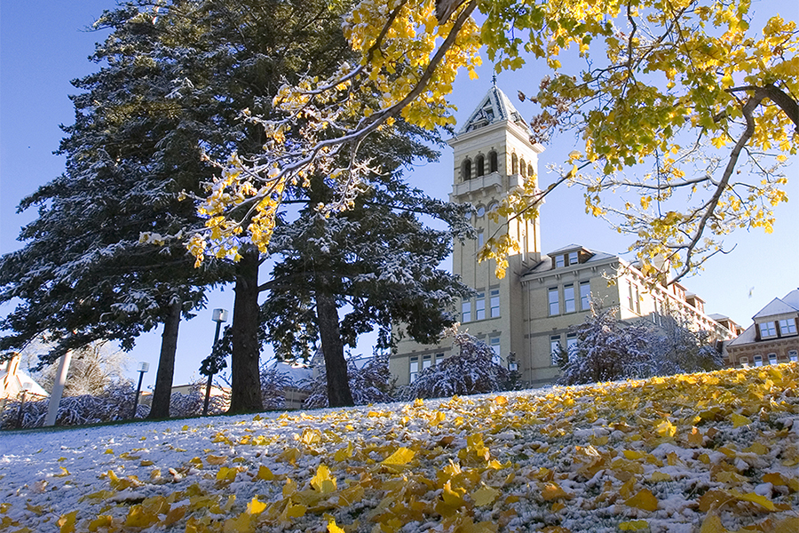 Old Main in autumn with snow.